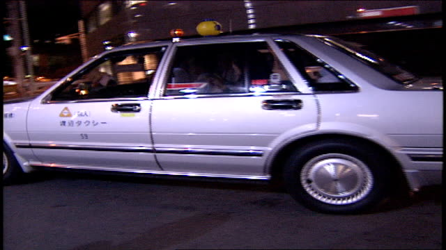 woman getting out of japanese taxi - 1990 stock videos & royalty-free footage