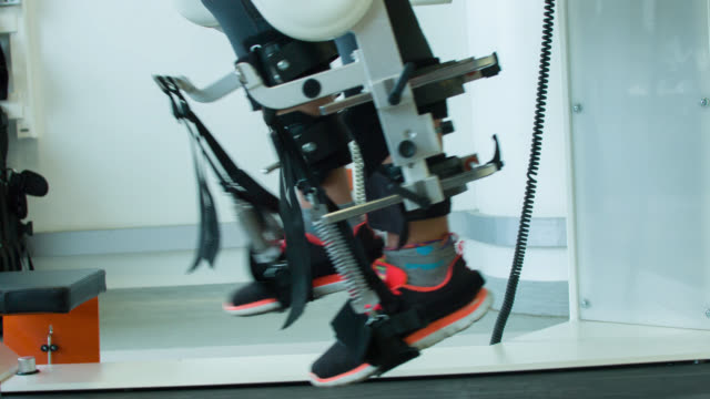 woman getting physical therapy on a robot machine - recovery stock videos & royalty-free footage
