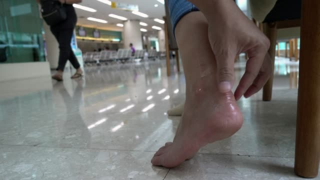 woman getting physiotherapy for her ankle. - ligament stock videos and b-roll footage