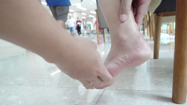 woman getting physiotherapy for her ankle. - twisted stock videos & royalty-free footage