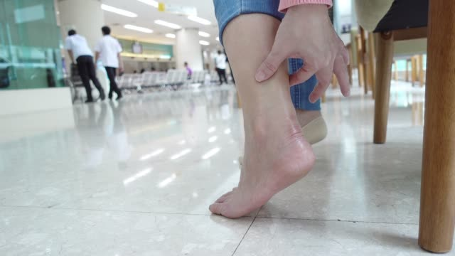 woman getting physiotherapy for her ankle. - tendon stock videos & royalty-free footage