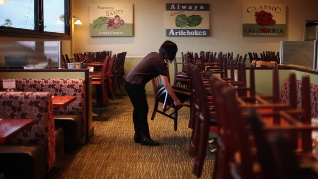 ws woman getting restaurant ready / truxton's, california, usa - chairs in a row stock videos & royalty-free footage