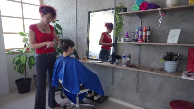 woman getting short hair cut - hair clipper stock videos & royalty-free footage
