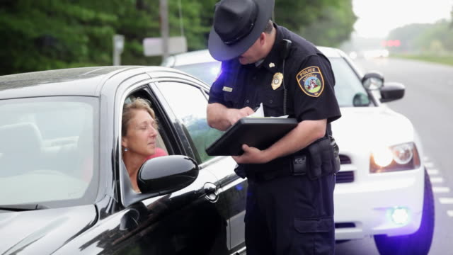 MS TU Woman getting traffic ticket / Eastville, Virginia, United States
