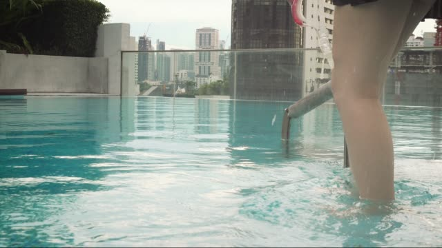 woman getting upon the pool at sunset. - bikini stock videos & royalty-free footage