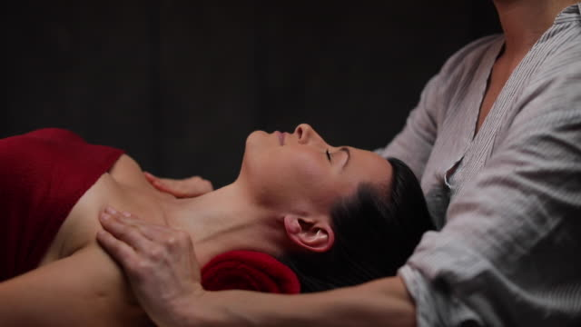 woman getting zen massage at health spa - massage table stock videos & royalty-free footage