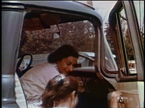 1958 pan woman + girl climbing into cab of truck + waving as truck pulling trailer pulls away - camper van stock videos and b-roll footage