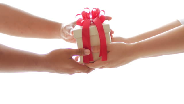 woman gives a gift box on celebration day - dare video stock e b–roll
