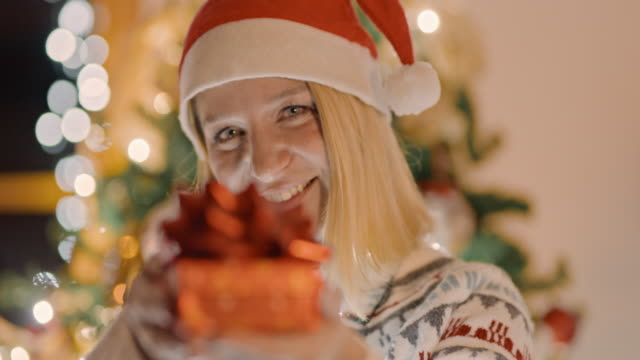 ds ms woman giving a christmas present - advent stock videos & royalty-free footage