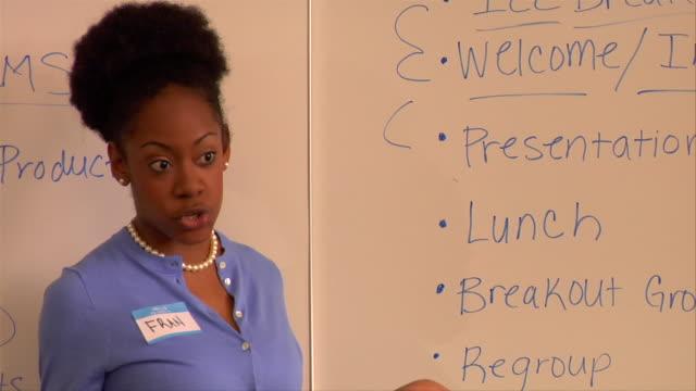 cu, woman giving presentation in conference room - strategia di vendita video stock e b–roll