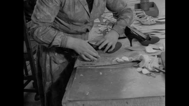 woman glues inner soles to shoes; 1956 - production line worker stock videos & royalty-free footage