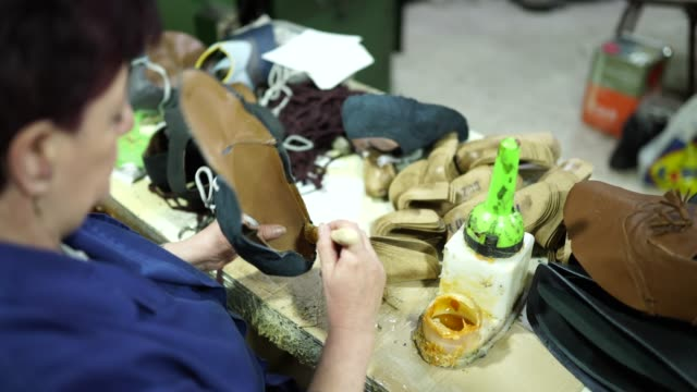 woman gluing inside of leather shoe - leather stock videos & royalty-free footage