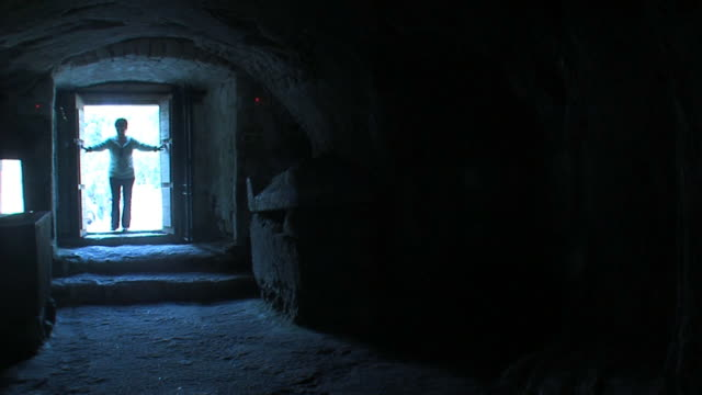 woman goes in crypt - crypt stock videos & royalty-free footage