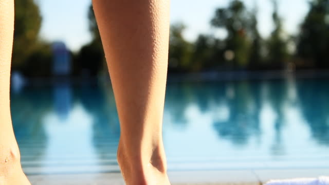hd dolly: woman going for a swim in pool - bathrobe stock videos & royalty-free footage