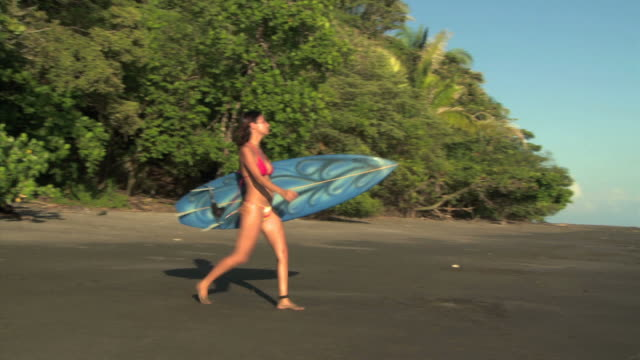 woman going to surf - see other clips from this shoot 1157 stock videos & royalty-free footage