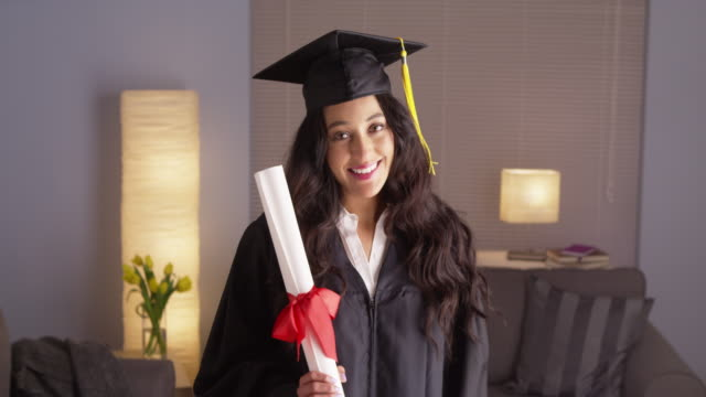 woman graduate smiling with degree