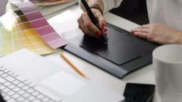 woman graphic designer using digital drawing tablet at advertising agency office