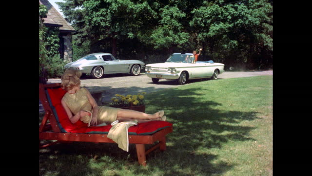 Woman Greets White Convertible Chevrolet Corvair