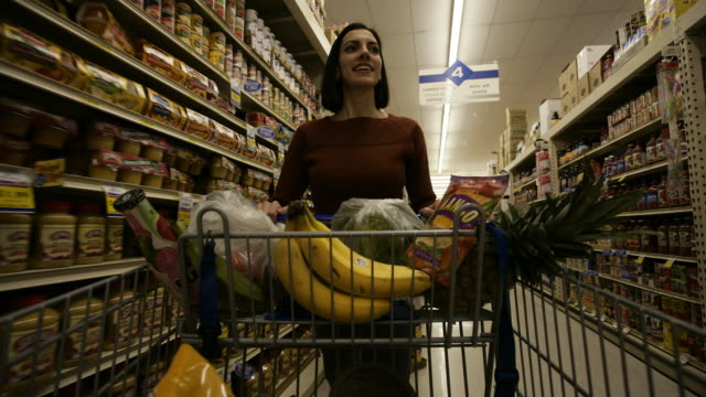 a woman grocery shopping - see other clips from this shoot 1172 stock videos & royalty-free footage