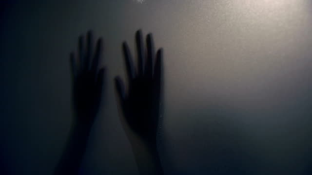 woman hand behind the matte glass - spooky stock videos & royalty-free footage