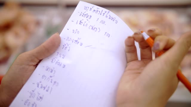 cu : woman hand checking a shopping list - list stock videos & royalty-free footage