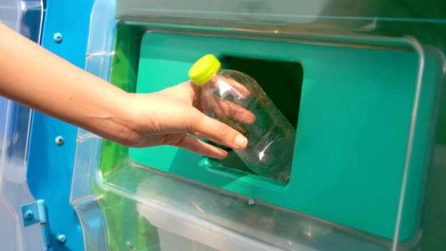 slo mo woman hand droping plastic bottles in recycle bin garbage - disposal container stock videos and b-roll footage
