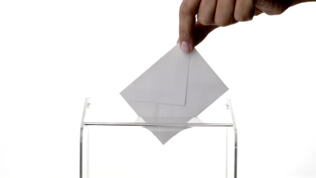 woman hand dropping envelope into voting ballot - voting stock videos & royalty-free footage