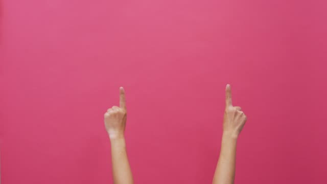 woman hand gesturing number one on isolated pink background 4k - oggetto creato dall'uomo video stock e b–roll