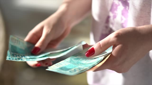 woman hand holding a the currency of reais, brazilian money - buy single word stock videos & royalty-free footage