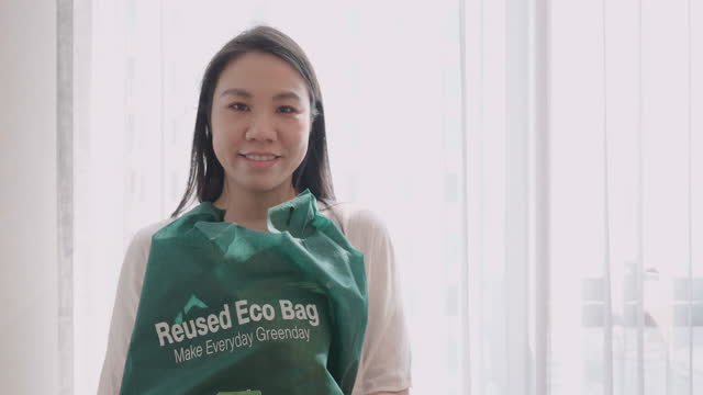 woman hand holding reusable shopping bags and products - ease stock videos & royalty-free footage