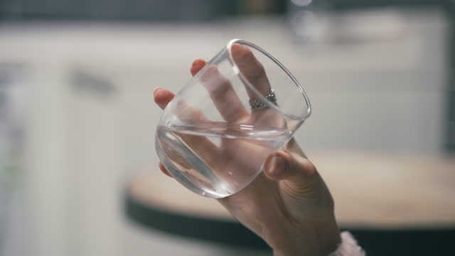 woman hand holding water glass - human finger stock videos & royalty-free footage
