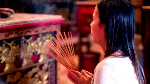 Woman Hand Lighting Incense Sticks