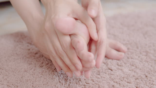 woman hand massaging on her cramp foot. - cramp stock videos & royalty-free footage