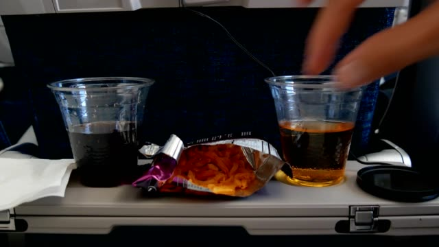 woman hand picking snack on airplane - snack stock videos & royalty-free footage