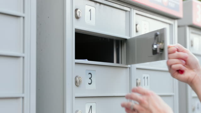 woman hand picking up the mail at postal mailbox - letterbox stock videos and b-roll footage