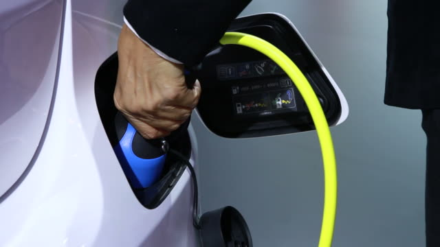 woman hand refueling alternative energy with car charger
