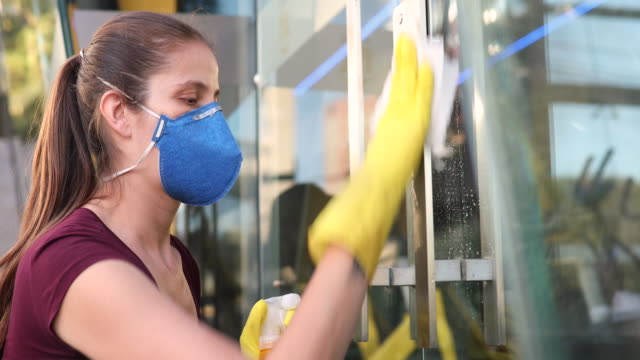 woman hand spraying alcohol sanitizer on door handle - rubbing alcohol stock videos & royalty-free footage