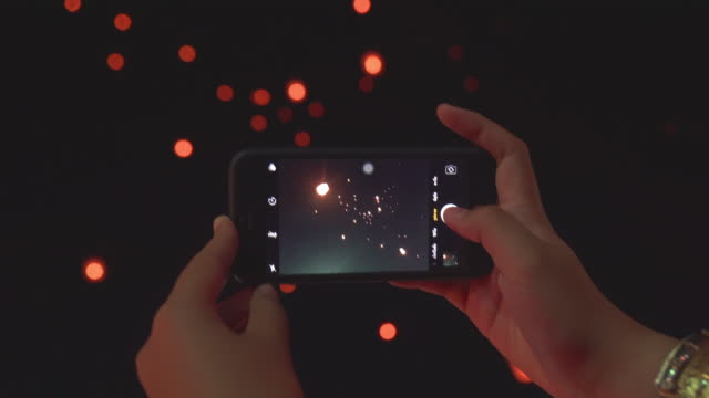 woman hand taking sky lantern picture with smart phone - lantern stock videos & royalty-free footage