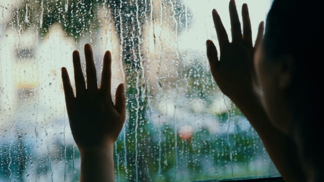 woman hand touch window with rain drops - activity stock videos & royalty-free footage