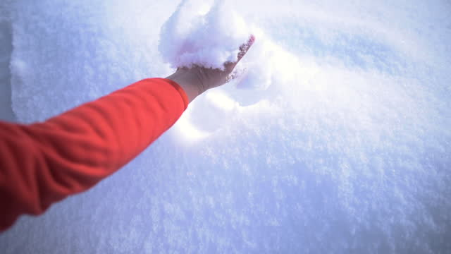 woman hand touching on first snow of the year - tinsel stock videos & royalty-free footage