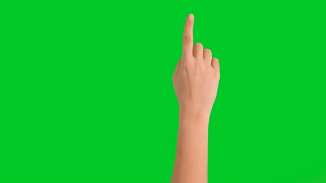 vídeos de stock e filmes b-roll de 4k woman hand touchscreen gestures on green screen - green