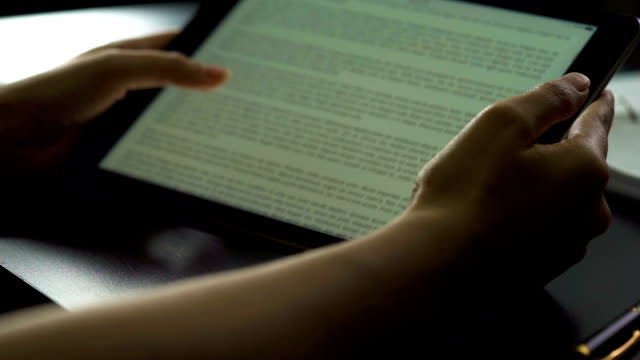 woman hand using tablet to reading on ebook