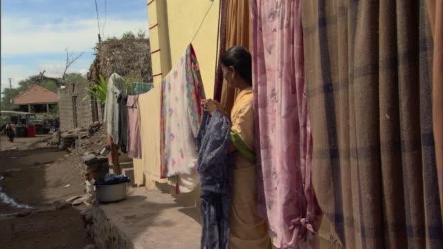 MS ZI PAN Woman handling laundry outside house, Pune, Maharashtra, India