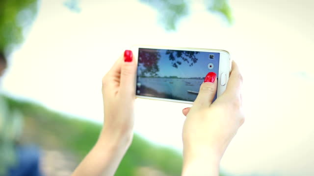 Woman hands capturing memories with phone