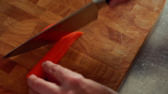 woman hands chopping carrots - schneiden stock videos & royalty-free footage