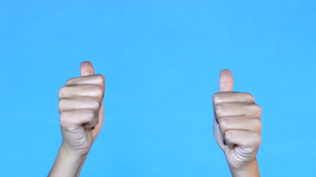 4K Woman hands clapping and showing thumbs up over - Blue background