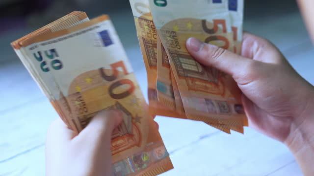 woman hands counting euro banknotes money and calculator cost. - exchange rate stock videos & royalty-free footage