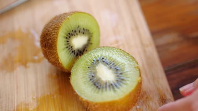 woman hands cutting on kiwi fresh fruit - slice stock videos & royalty-free footage