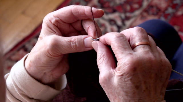 Woman hands doing knitting