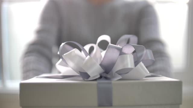 woman hands holding a gift box showing to camera - wrapped stock videos & royalty-free footage